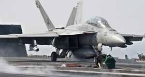 A US Navy F/A-18 Hornet launches off from the flight deck of the US Navy aircraft carrier USS George HW Bush in the Persian Gulf, at sea, yesterday. Aircraft from the carrier are part of the US military aircrafts conducting strikes against the Islamic State (IS) extremists in northern Iraq to halt their advance. EPA/MAZEN MAHDI