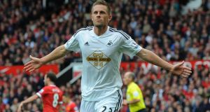 Swansea City's Gylfi Sigurdsson cerebrates scoring the winner against Manchester United. Photograph:  Peter Powell / EPA