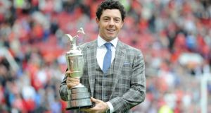 Rory McIlroy holds the British Open Claret Jug  on the Old Trafford pitch during half time.  Photograph :Martin Rickett/PA Wire.