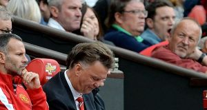 Manchester United manager Louis van Gaal in the dugout at Old Trafford. Photograph: Peter Powell / EPA
