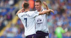 Aidan McGeady (left) of Everton celebrates his goal with James McCarthy  at the King Power Stadium. Photograph:  Michael Regan/Getty Images