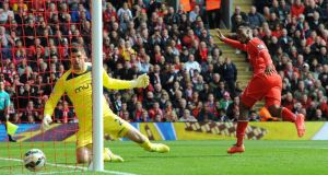 Liverpool's Daniel Sturridge scores the winner against Southampton at  Anfield. Photograph: Peter Powell / EPA
