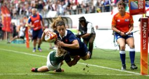 Elodie Guiglion of France dives to score against Ireland  in the IRB Women's Rugby World Cup 2014 3rd/4th Place Playoff at Stade Jean-Bouin  in Paris. Photograph:  Jordan Mansfield/Getty Images