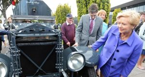 Ministrer for Justice Frances Fitzgerald and Minister of State Simon Harris , examining the armoured car which transported the wounded Michael Collins from Béal na Bláth at the annual Michael Collins and Arthur Griffith Commemoration, at Glasnevin Cemetary, Dublin, today. Photograph: Eric Luke/The Irish Times