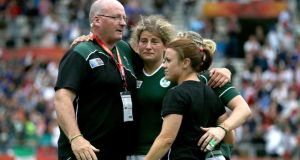 Ireland's head coach Philip Doyle with Jenny Murphy, Lynne Cantwell and Niamh Briggs after the defeat to France. Photograph: Dan Sheridan / Inpho