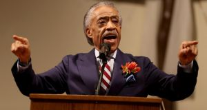The Rev Al Sharpton speaks at the Greater St Mark church in Ferguson, Missouri, yesterday  as the community seeks answers about the police shooting of Michael Brown. Photograph: Joe Raedle/Getty Images