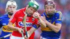 Cork's Alan Cadogan and Paddy Stapleton of Tipperary clash in yesterday's All-Ireland hurling semi-final. Photograph: Cathal Noonan/Inpho
