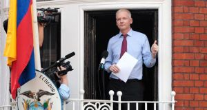 Wikileaks founder Julian Assange is seen on the balcony of the Equador embassy in Knightsbridge on August 19th, 2012.  Photograph: Rosie Hallam/Getty Images.