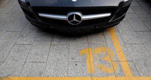 A new Mercedes-Benz car is seen at a parking lot outside a dealership in Beijing. German luxury carmaker Mercedes-Benz has been found guilty of manipulating prices for after-sales services in China, the official Xinhua news agency reported, citing regulators. Photograph:  Petar Kujundzic/Reuters