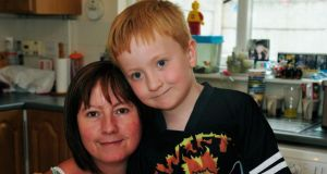 Max Dunne (6), who has asthma, with his mother, Orla,  in their home in Tallaght, Co Dublin. Photograph: Aidan Crawley