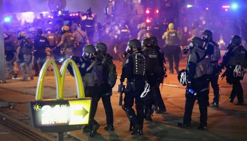 Police advance on protesters in Ferguson. Photograph: Scott Olson/Getty Images