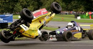 A David Sleator photograph showing Enda O Connor's racing car being nudged over by Adam Craughan during a first corner incident during the Hilton Kilmainham Phoenix Park Races in 2007. Photograph: David Sleator/The Irish Times