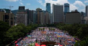 Protesters gather to march in the streets to demonstrate against the pro-democracy Occupy Central campaign in Hong Kong on Sunday. Photograph: Tyrone Siu/Reuters