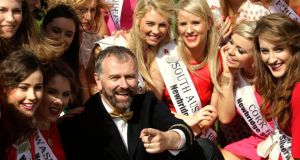 Host Daithi O Se with some of the 32 Irish and International Roses taking part in the 2014 International Rose Selection at the launch of this years Rose of Tralee Festival last week. Photograph: Brian Lawless/PA Wire