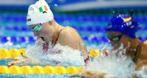Fiona Doyle of Ireland (left) and Jessica Vall Montero of Spain compete in the women's 100m Breaststroke preliminaries at the 32nd LEN European Swimming Championships 2014 at the Velodrom in Berlin. Photograph: David Ebener/EPA