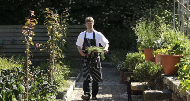 Graham Neville, the chef at Restaurant FortyOne, pictured in a walled garden in Killiney, Co Dublin where much of the award winning restaurant's food came from. Photograph: Collins Dublin.