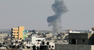 A plume of smoke  after what witnesses said was an Israeli air strike in Gaza City  today. Photograph: Suhaib Salem/Reuters