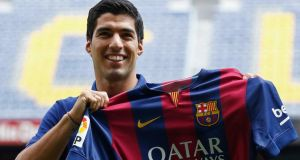 Luis Suarez was officially unveiled as a Barcelona player  at Camp Nou on Tuesday. Photograph:  Gustau Nacarino/Reuters