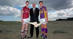 Galway's Cathal Mannion and Wexford's Conor McDonald with former Cork goalkeeper Ger Cunningham at the launch of the Bord Gáis Energy All-Ireland U-21 hurling semi-finals at Clanna Gael Fontennoy GAA club in Ringsend, Dublin. Photo: Donall Farmer/Inpho