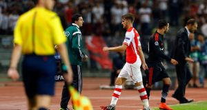 Arsenal's Aaron Ramsey leaves the field after receiving a red card during the first leg of their Champions League qualifying soccer match against Besiktas at Ataturk Olympic stadium in Istanbul. Photograph:  Murad Sezer/Reuters