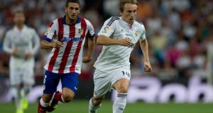 Luka Modric in action against Koke of Atletico de Madrid  during the Supercopa first leg match between Real Madrid and Club Atletico de Madrid at Estadio Santiago Bernabeu. Photograph: Gonzalo Arroyo Moreno/Getty Images