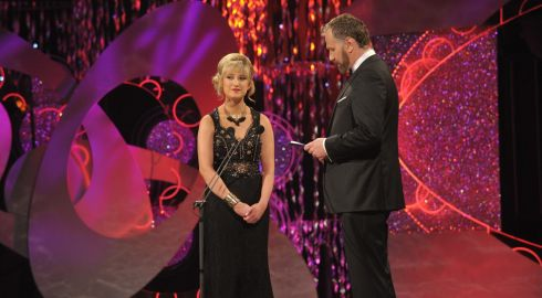 Donegal Rose Tamara Payne (19) pictured on stage with presenter Daithi O'Se during the 2014 Rose of Tralee . Ms Payne, the youngest participant, told the audience she had a lamb called Lulu and  and read a poem she composed for a friend who had died. Photograph: Domnick Walsh / Eye Focus LTD
