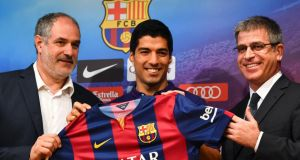 FC Barcelona Sport Director Andoni Zubizarreta, Luis Suarez and  Jordi Mestre  pose for the media during a press conference. The club had their transfer ban appeal tuned down by Fifa. Photograph: David Ramos/Getty Images