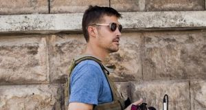 YouTube is taking action to remove any video which porports to be of James Foley's murder on its site and close accounts belonging to terrorist organisations, it said today. File photograph of James Foley: Nicole Tung / Courtesy of Global /EPA