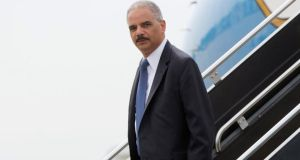 US attorney general Eric Holder arrives at Lambert-St. Louis airport yesterday. Photograph: Reuters/Pablo Martinez Monsivais