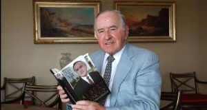 Former taoiseach Albert Reynolds photographed with a copy of his autobiography in September 2009. Photograph: Brenda Fitzsimons/The Irish Times.
