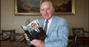 Former Taoiseach Albert Reynolds photographed with a copy of his autobiography at his home. Photograph: Brenda Fitzsimons/The Irish Times