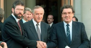 Photograph: Matt Kavanagh 6th  An image from September 1994 showing the then taoiseach Albert Reynolds (centre) shaking hands with Sinn Féin leader Gerry Adams (left) and SDLP leader John Hume outside Government Buildings after a discussion of ways to advance the peace process following the IRA's ceasefire announcement of August 31st. Photograph: Matt Kavanagh/The Irish Times