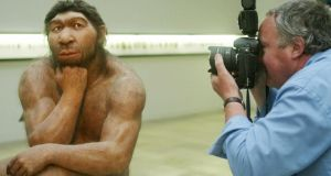 A photographer taking pictures of a reconstruction of a Neanderthal man ancestor displayed  at the Prehistoric Museum in Halle,  Germany. Photograph: Sebastian Willnow/AFP/Getty Images.