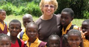 Nancy Writebol with children in Liberia in October 2013. She is one of two Americans working for a missionary group in Liberia who were infected with the Ebola virus, and who have been discharged from Emory University Hospital in Atlanta after receiving treatment. Photograph: AP courtesy Jeremy Writebol
