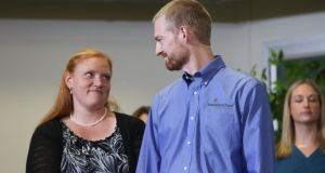 Kent Brantly, an Ebola patient at Emory University Hospital in Atlanta, with his wife, Amber Brantly, during a press conference announcing his release from the hospital yesterday. Photograph: Jessica McGowan/Getty Images