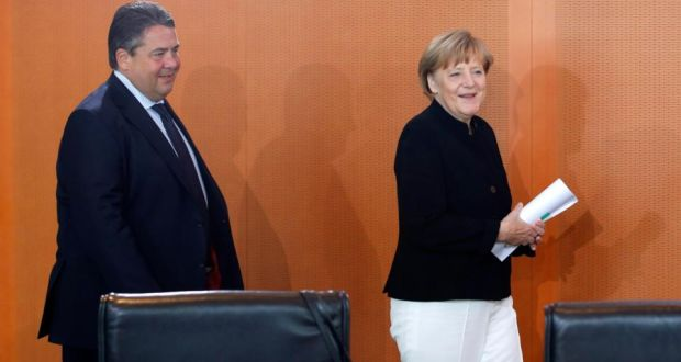 German Chancellor Angela Merkel and Economy Minister Sigmar Gabriel arrive for a cabinet meeting at the Chancellery in Berlin. Photograph: Fabrizio Bensch/Reuters