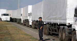 A Russian aid convoy of white trucks waits to enter Ukraine at a border control point with Ukraine in the Russian  Rostov region. Photograph: EPA.