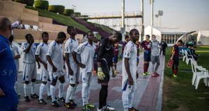 Students with Aspire Football Dreams, in white, line up before a match with FC Barcelona's youth team, in Doha, Qatar, on January 27th, 2014. Phtograph: Bryan Denton/The New York Times