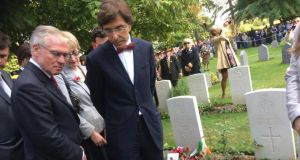 Belgian prime minister Elio di Rupo (right) stands in front of Maurice Dease's grave in Mons. Photograph: Ronan McGreevy