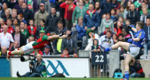 Kerry's Kieran O'Leary scores the equalising point despite the efforts of Mayo's Colm Boyle at Croke Park. Photograph: Cathal Noonan/Inpho
