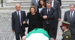 Kathleen Reynolds follows the coffin as it is carried from the Mansion House. Photograph: Nick Bradshaw
