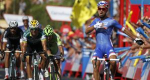 French rider Nacer Bouhanni of FdJ team celebrates winning the second stage of the 2014 Vuelta a Espana cycling tour over 174.4km from Algeciras to San Fernando, southern Spain. Photograph: Javier Lizon/EPA
