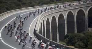 The peleton in action in action during the second stage of the Vuelta a España over 174.4km from Algeciras to San Fernando, southern Spain. Photograph: Carrasco Ragel/EPA