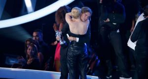 Miley Cyrus hugs her spokesperson Jesse after he accepted the award for video of the year on her behalf. Photograph: Lucy Nicholson/Reuters