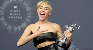 Singer Miley Cyrus poses backstage after winning Video of the Year for 'Wrecking Ball'.  Photograph: Kevork Djansezian/Reuters