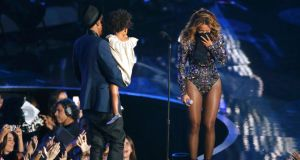 Beyonce reacts as her husband Jay-Z carries their daughter Ivy Blue onstage to present the Video Vanguard Award during the 2014 MTV Video Music Awards in  California yesterday. Photograph: Mario Anzuoni/Reuters