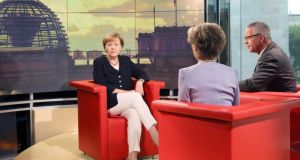 German Chancellor Angela Merkel (L) sits in the 'Haupstadtstudio' of German television station ARD. Data released this morning shows that German business confidence declined for a fourth month in August, reflecting a faltering euro-area economy that European Central Bank President Mario Draghi says might need more stimulus. Photograph: STEPHANIE PILICK/EPA