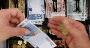 Average weekly earnings in the public sector in the second quarter of this year were €919, almost €300 higher than €622 recorded for the private sector. Photograph: Reuters/Michaela Rehle