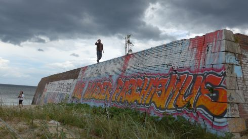 "A building foundation turned pier at the Nazi/East German complex at Prora on the island of Rügen. The graffiti says ""Nie Wieder Faschismus"" - never again fascism. Photograph: Derek Scally."
