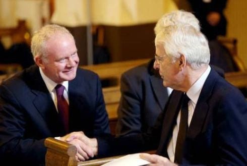 Northern Ireland Deputy First Minister Martin McGuinness shakes hands with former British prime minister John Major at the funeral of former taosieach Albert Reynolds at the Sacred Heart Church in Donnybrook, Dublin today. Photograph: Maxwell's.